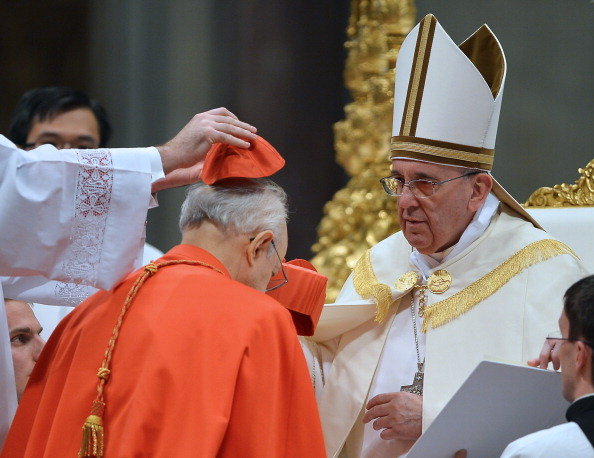 Cardinal Lorenzo Baldisseri receives the red hat from Pope Francis, Feb. 22, 20 14. A. D.