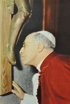 Pope Pius XII venerates the Cross